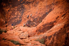Rock clin=mbers on red cliffs
